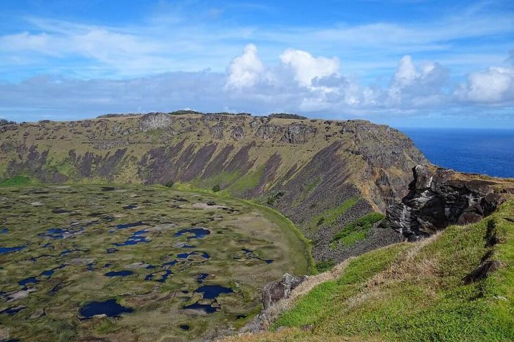 View from the west side of the crater at Rano Kau, looking towards the southern side of the crater, where much of the crater wall has collapsed into the sea. Easter Island, Chile