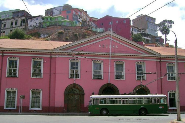 Trolleybus with the Customs House in the background in Valparaíso, Chile