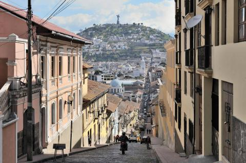 Quito, Ecuador, García Moreno street in historic center, Virgin of Quito in background